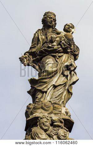 Statue Of Madonna And St. Bernard At Charles Bridge In Prague