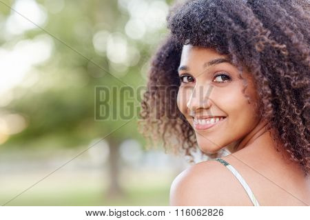 Beautiful mixed race woman smiling in nature