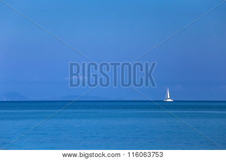 Lonely white yacht in the azure tropical sea