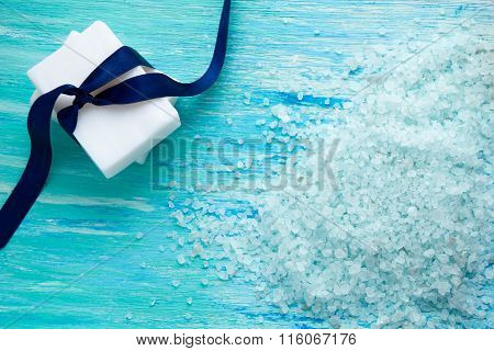 Natural Organic Soap, And Sea Salt S On A Blue Wooden Table