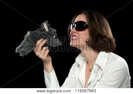 Silly Model With Sunglasses Playing With Stuffed Animal