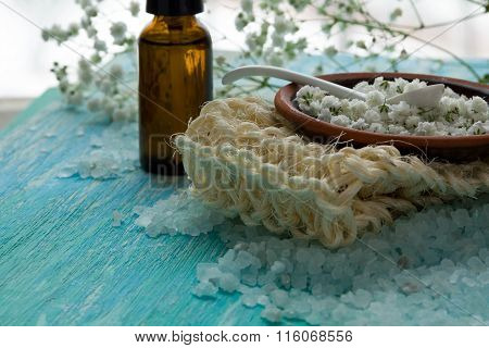Bottles Essential Oil And Sea Salt Herbal Bath  On A Blue Wooden Table, Spa