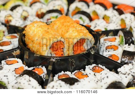 Close up on fried sushi with many other sushi pieces