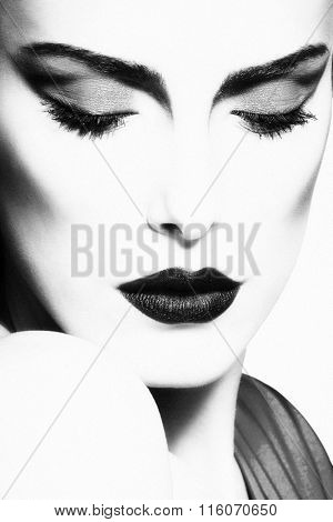 glamorous woman beauty portrait in black and white, small amount of grain added, studio shot, close up