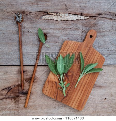 Alternative Medicine And Seasoning - Branch Of Fresh Sage  And Dried Tied Sage Set Up On Old Wooden