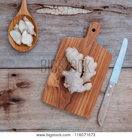 Alternative Medicine And Seasoning - Ginger Root And Dried Ginger In Wooden Spoon Set Up On Old Wood