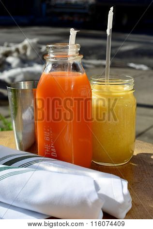 two fresh fruit juices on a table
