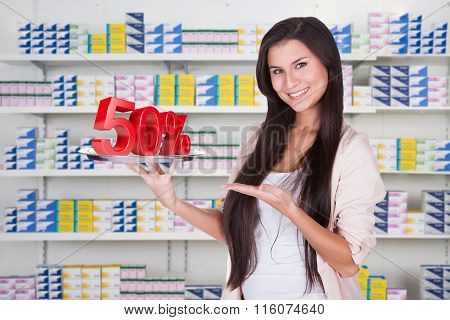 Woman Presenting 50% Discount On Silver Platter
