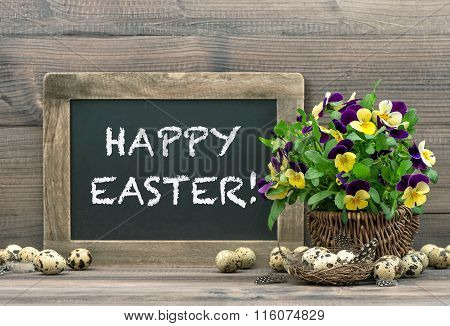 Easter Decoration With Eggs, Pansy Flowers, Blackboard