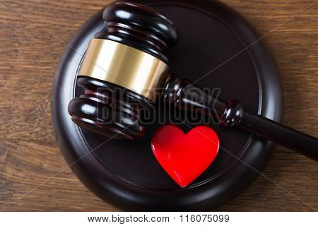 Mallet And Heart On Table In Courtroom