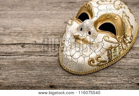 Carnival Mask Harlequin On Rustic Wooden Background