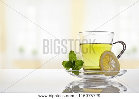 Cup Of Green Tea With Mint And Lemon Front View