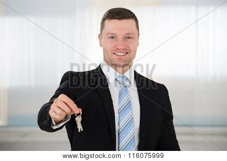 Happy Real Estate Agent Giving House Keys