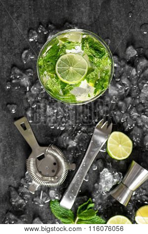 Cold Cocktail With Lime, Mint, Ice. Drink Making Tools
