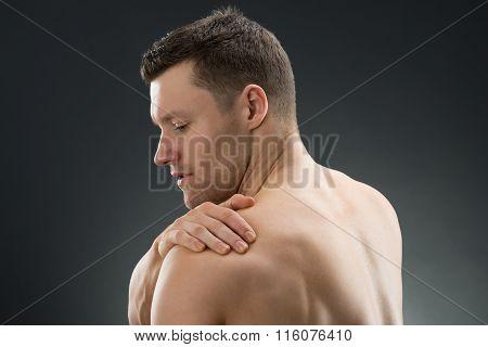 Muscular Man Suffering From Shoulder Ache