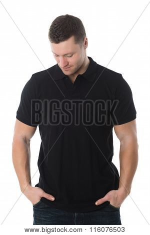 Handsome Man In Casuals Standing With Hands In Pockets