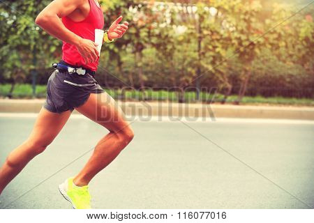 young fitness marathon runner running at road