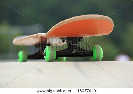 closeup of one skateboard at skatepark ramp