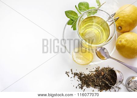 Green Tea With Mint Lemon And Metal Strainer Top View