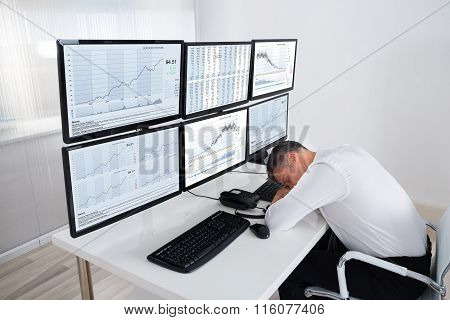 Stock Trader Sleeping At Multiple Computer's Desk