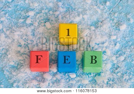 February 1st. Calendar date on color wooden cubes with marked Date of 1st Of february
