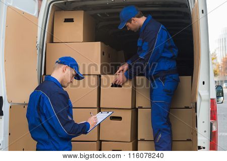Delivery Men Unloading Boxes