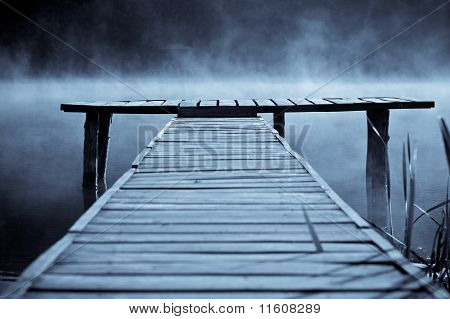 Wooden Pier On The Mountain River Or Lake