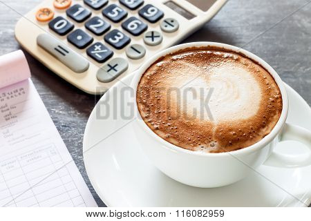 Coffee Cup On Work Station
