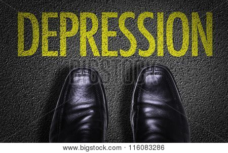 Top View of Business Shoes on the floor with the text: Depression