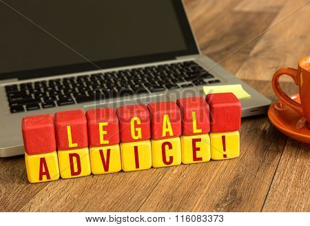 Legal Advice written on a wooden cube in a office desk