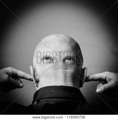 Man with eyes on nape