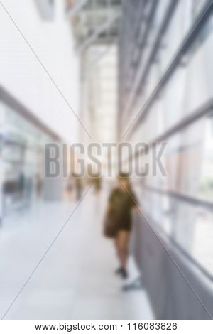 Abstract Image Of Woman In Town In The Rush Hour Of A Modern Business Center With A Blurred Backgrou