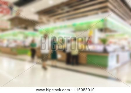 Abstract Image Of People In Town In The Rush Hour Of A Modern Business Center With A Blurred Backgro