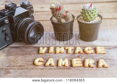 Old Retro Camera On Vintage Wooden Boards With Vintage Camera Text, Abstract Background