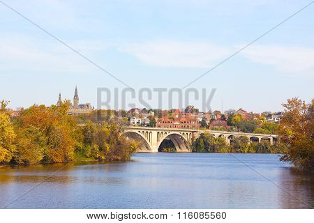 A view on Key Bridge and historic buildings across Potomac River in autumn.