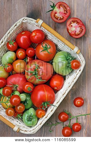 Fresh Red And Green Tomatoes In A Basket