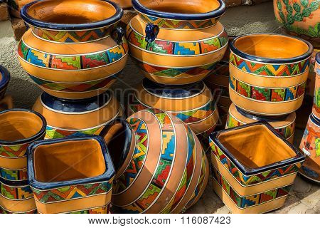 Traditional glazed Mexican talavera style pottery in southwestern patterns.