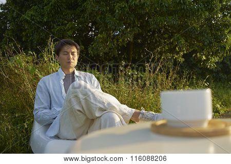 Man Meditating Outdoor In The Morning