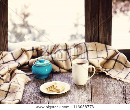 White Cup Of Coffee Or Tea, Blue Pot On Stylized Wooden Window Sill.