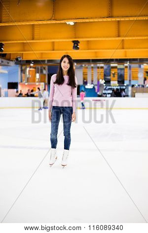 Asian woman ice skating indoor ice rink