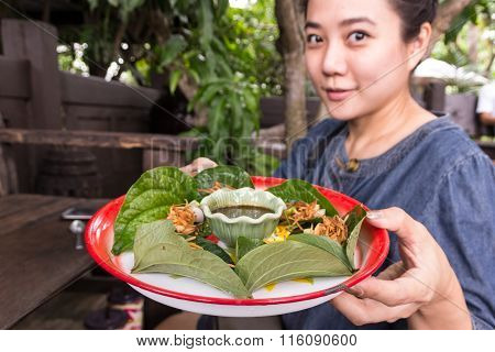 Woman Hold Miang Kum