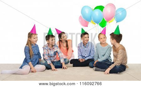 happy smiling children in party hats on birthday
