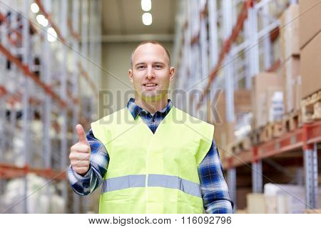 happy man showing thumbs up gesture at warehouse