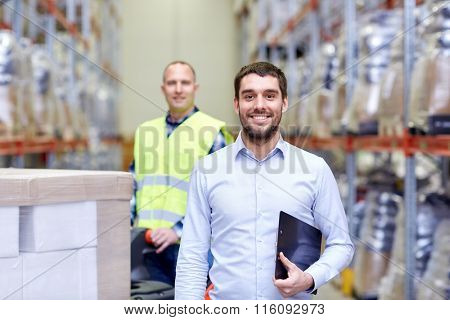 businessman with clipboard  over warehouse loader