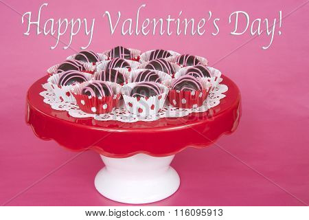Chocolate Cake Balls In Red And White Dot Liners On Red Plate Pink Background