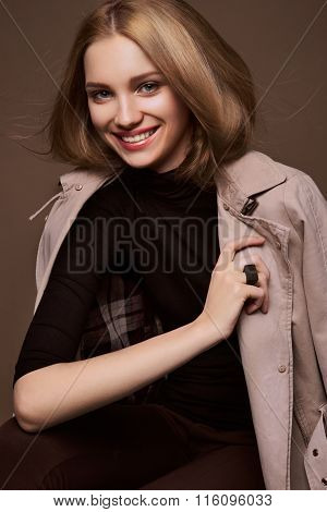 Beauty Woman. Beautiful Young Female. Portrait isolated on Brown Background. Healthcare. Perfect Ski