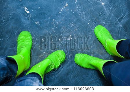 green rubber boots in the water