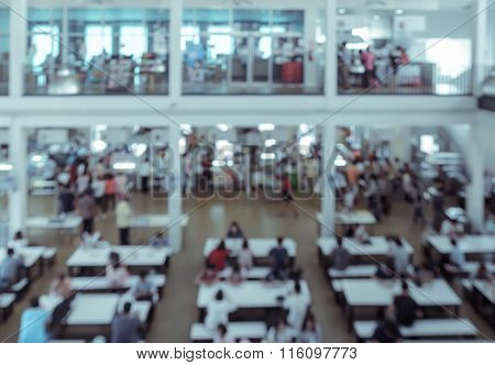 Abstract Of Blurred People In Food Court