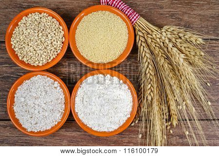 Four small bowls with whole wheat, couscous, whole wheat flour, all purpose flour and sheaf of wheat