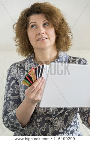 woman with tablet pc computer and credit card